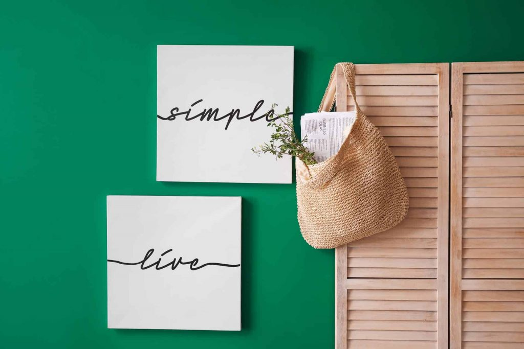 Wood screen and green wall with text about benefits of simplifying your life