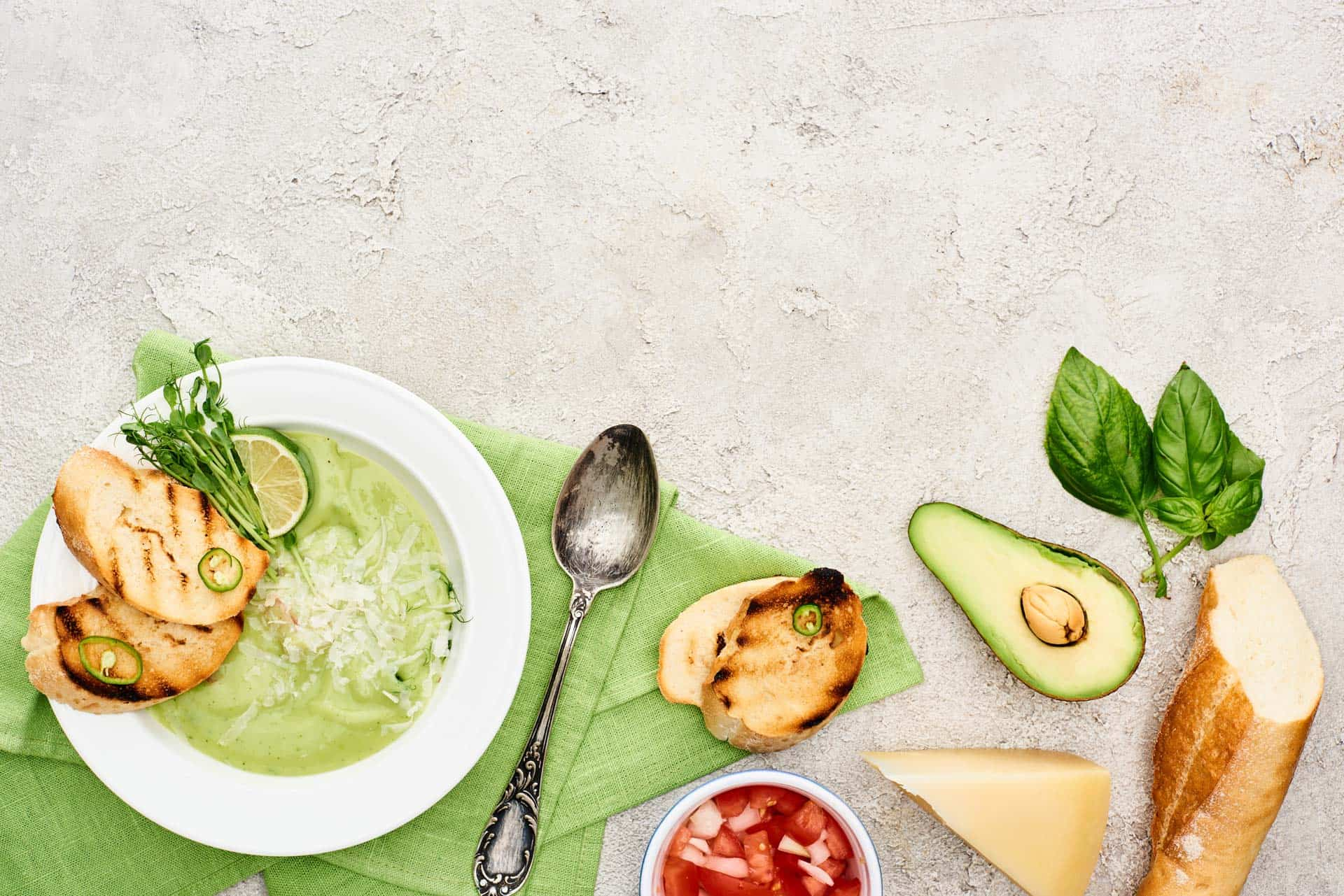 Low impact cooking with avocado, basil, bread, and soup