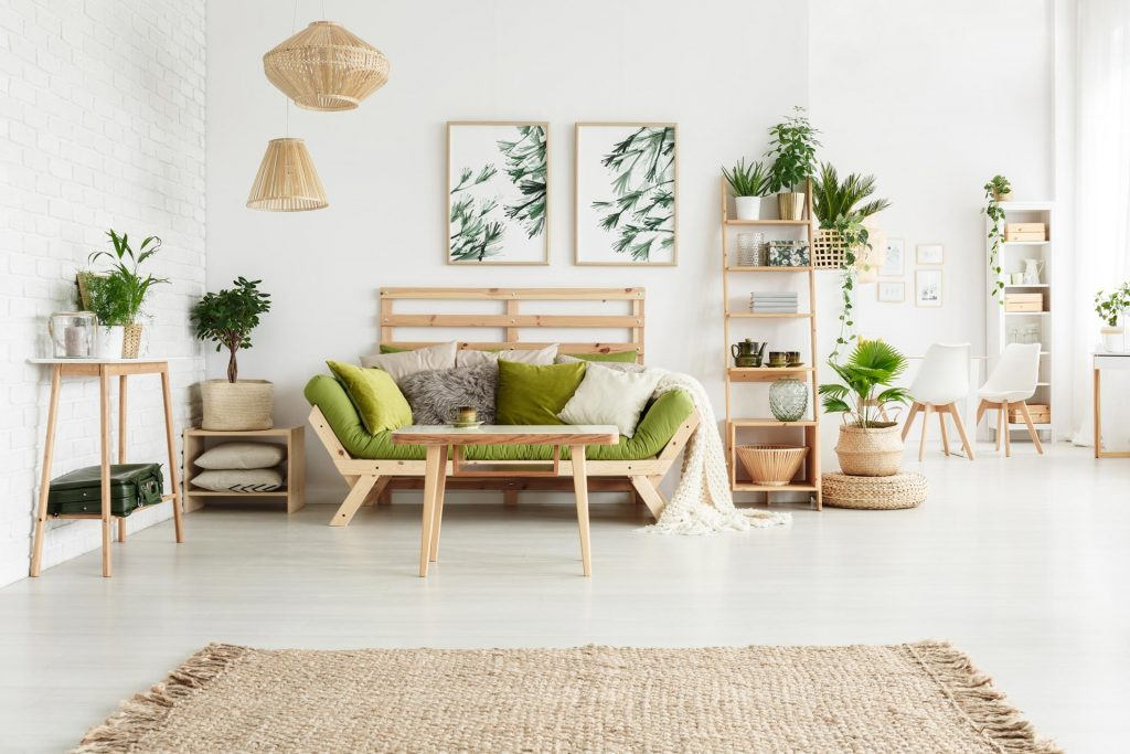 White and green living room with eco friendly home improvements, wooden couch, tan rug