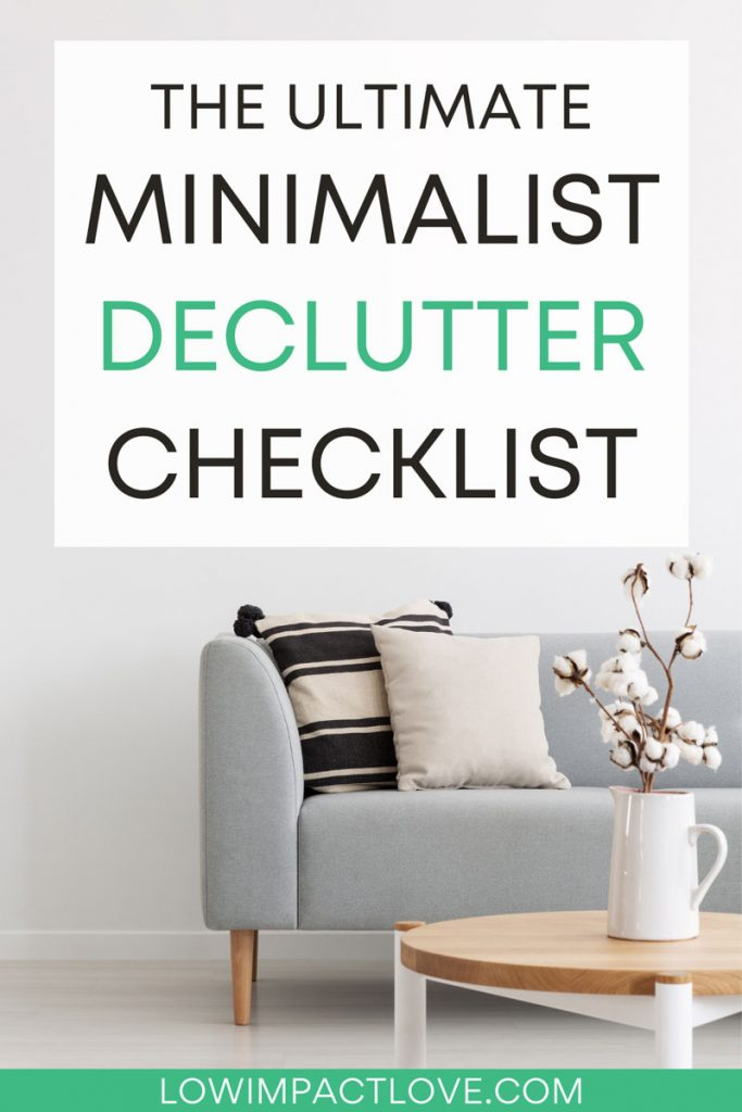 The ultimate minimalist decluttering checklist - grey couch with black and white pillows, wooden coffee table with plant on top