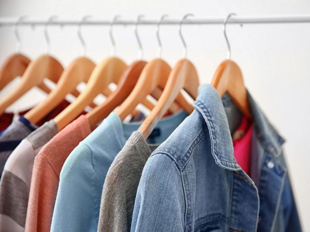 6 blouses hanging on rack, displaying fast fashion vs slow fashion