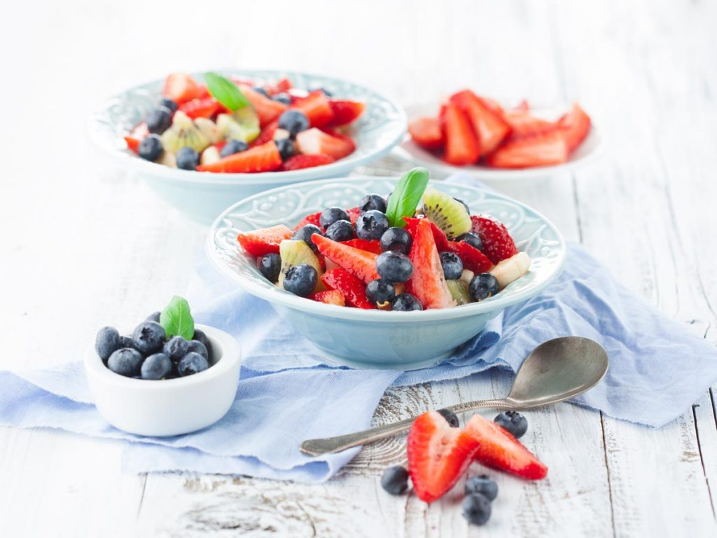 Bowls of strawberry and blueberry fruit salad are easy waste free snacks