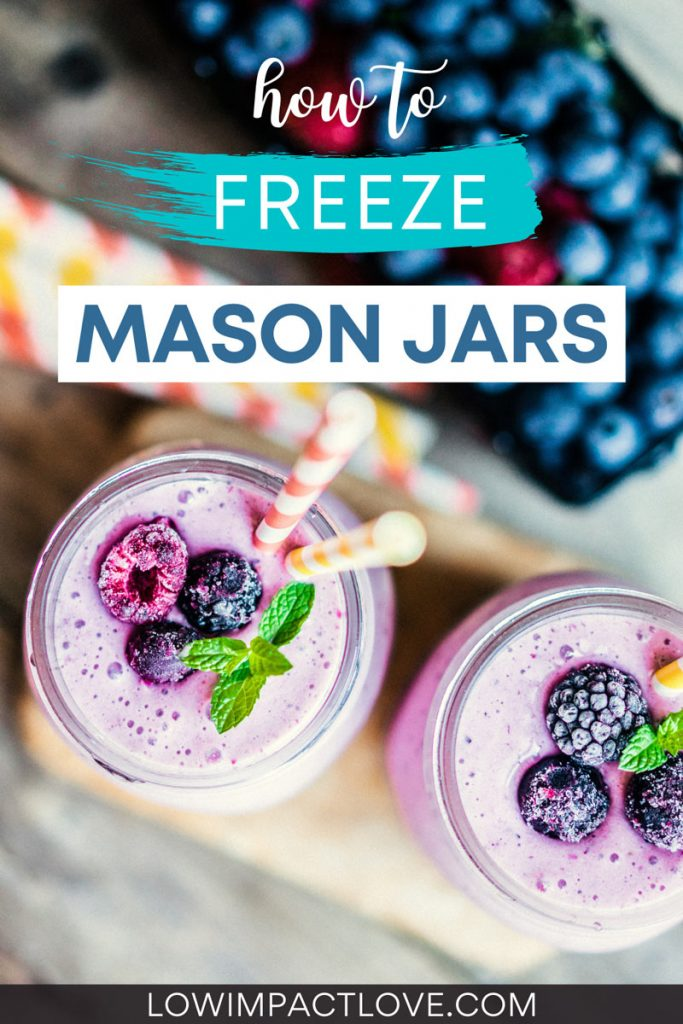 """Top down view of two blueberry smoothies inside jars, with text overlay - """"how to freeze mason jars""""."""