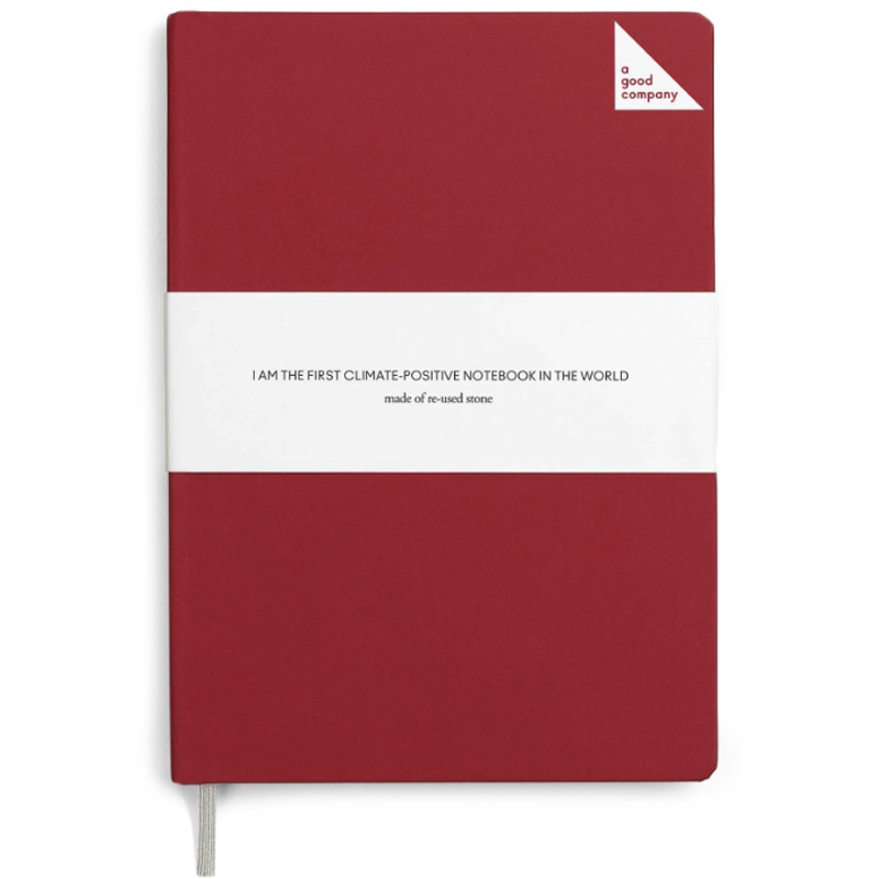 Isolated red eco friendly notebook by A Good Company.