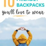 "Woman in yellow coat wearing blue backpack posing with hands over head, with text overlay - ""10 eco friendly backpacks you'll love to wear""."
