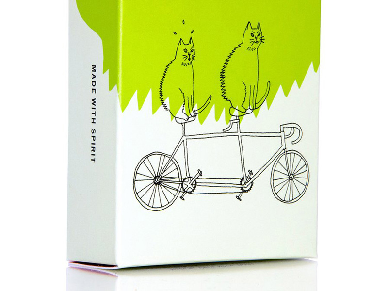 Isolated Meow Meow Tweet product box with two cats on bicycle.