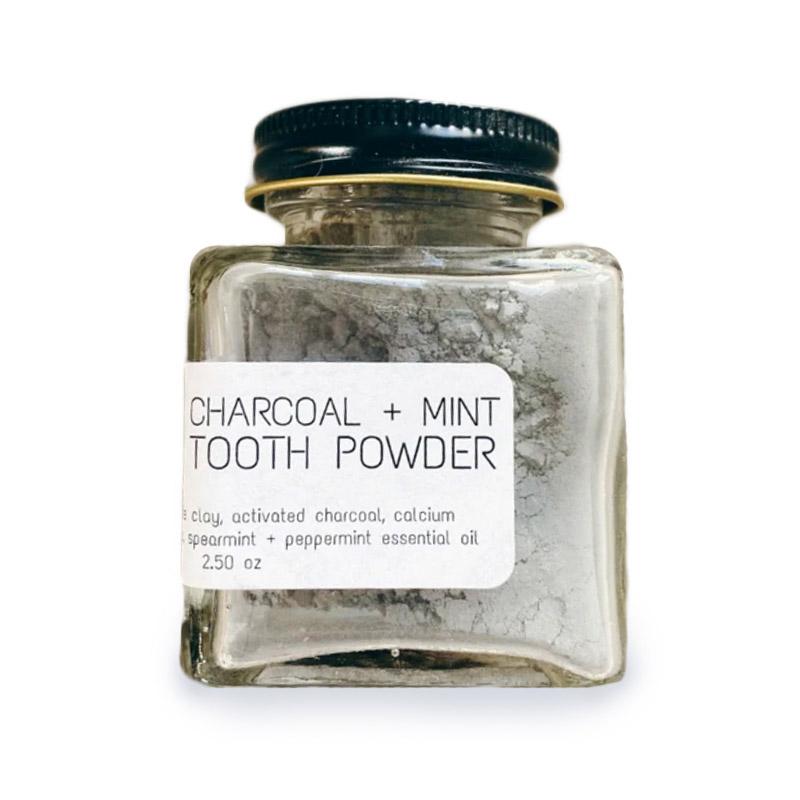 Isolated image of Bestowed Essentials zero waste toothpaste powder jar.
