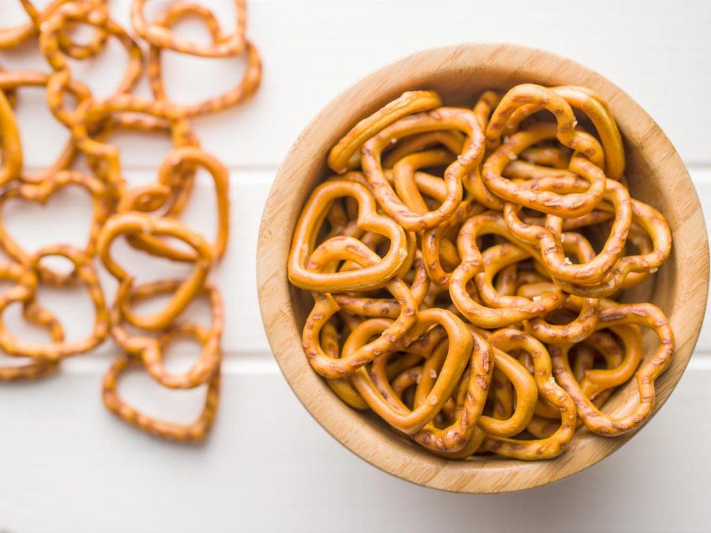 Wooden bowl of heart shaped pretzels.