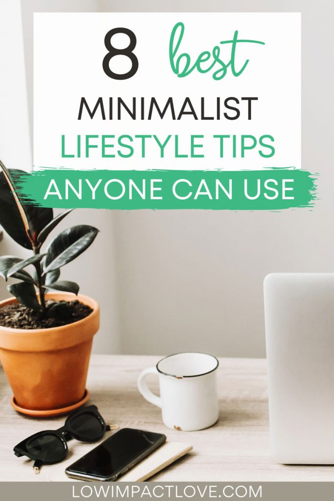 """Desk with potted plant, phone, mug, and laptop, with text overlay - """"8 best minimalist lifestyle tips anyone can use""""."""